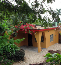The front view of the left side of The Kumquat Cottage in San Ignacio Belize